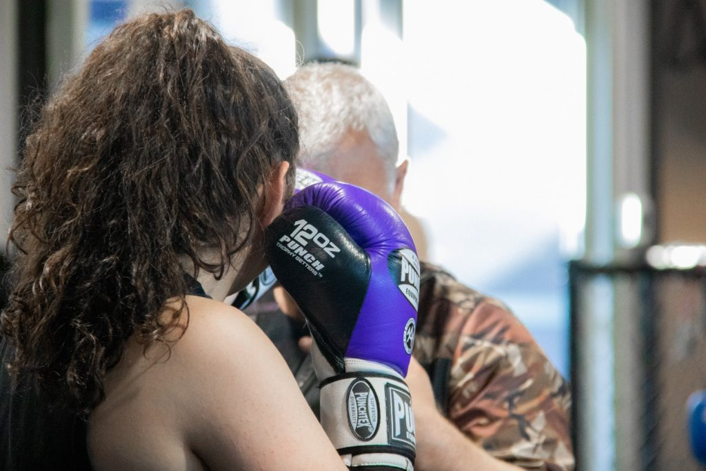 Women In Purple Gloves